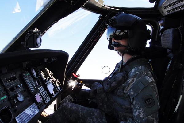 Luella Dooley-Menet flying a UH60 Blackhawk